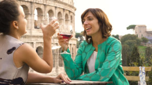 Two young women enjoying a late lunch in Rome, Italy