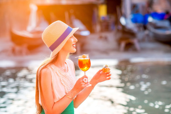 Enjoying an Aperol Spritz besides a canal in Venice