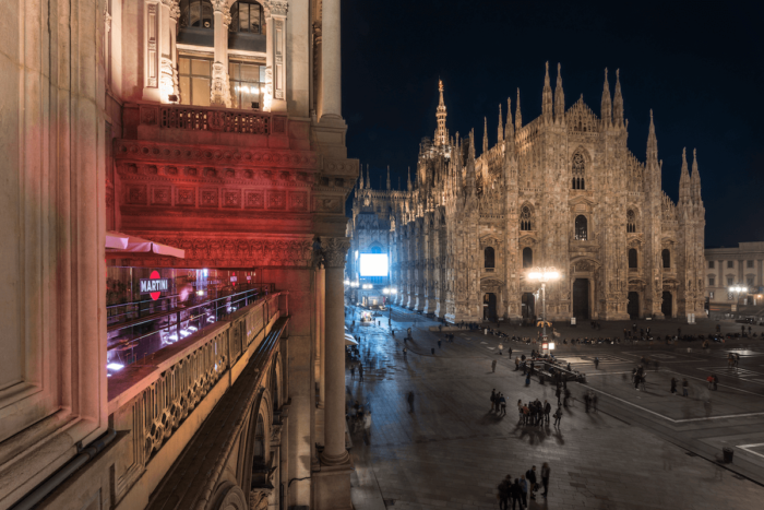 A nighttime view of Duomo 21 in Milan